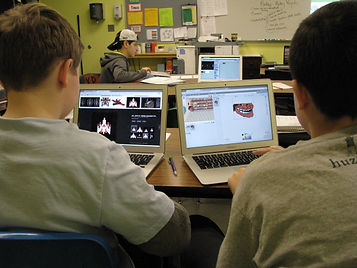 Two boys on their laptops