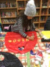 A girls creating a hero cape