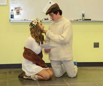 girl and boy acting out romeo and juliet