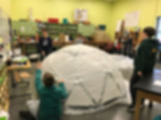 Kids creating a bubble fort