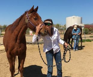 Sandy getting horsemanship lessons