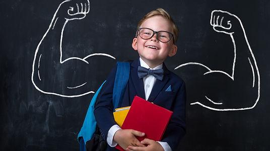 Cute child boy in school uniform and gla