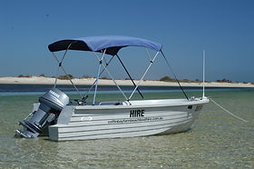A shade canopy makes this hire boat comfortable in summer