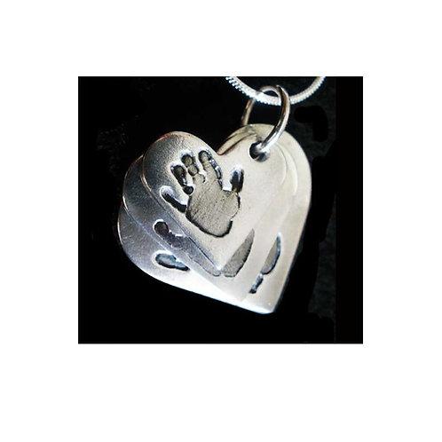 Triple descending silver keepsake heart pendant handprints basingstoke