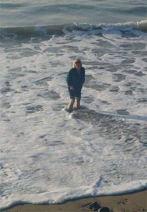 Sue Steadman standing in the waves