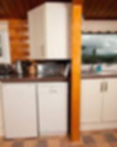Caban Eryri log cabin has a well equipped kitchen including a dishwasher.