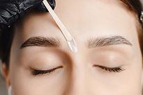 Master wax depilation of eyebrow hair in