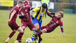 Sticker share six goals with St Piran rivals