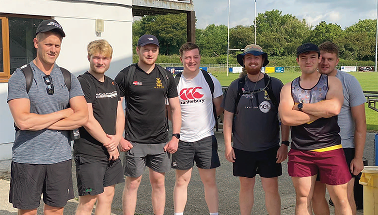 Alfie Martin has run a lap of Cornwall, visiting every rugby club in the county to raise cash for charity. Alfie, third from right, at the home of the Cornish All Blacks in Launceston