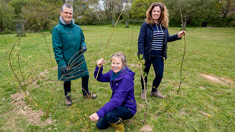 Left, Friends of Tincombe leader James Jenkins monitors pollution in the stream; right, volunteers Karen Roberts, Cathy Parson and Jo Allen work on a willow dome at Tincombe.