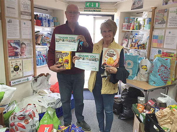 Saltash Foodbank has been helping the community since 2012; above, Brian and Janice Pinkham, of Saltash United FC and Saltash Rock Choir respectively, are recognised for supporting the foodbank