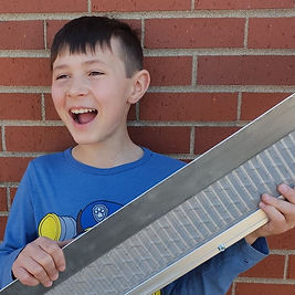 kid-holding-spartan-gutter-guard-square.