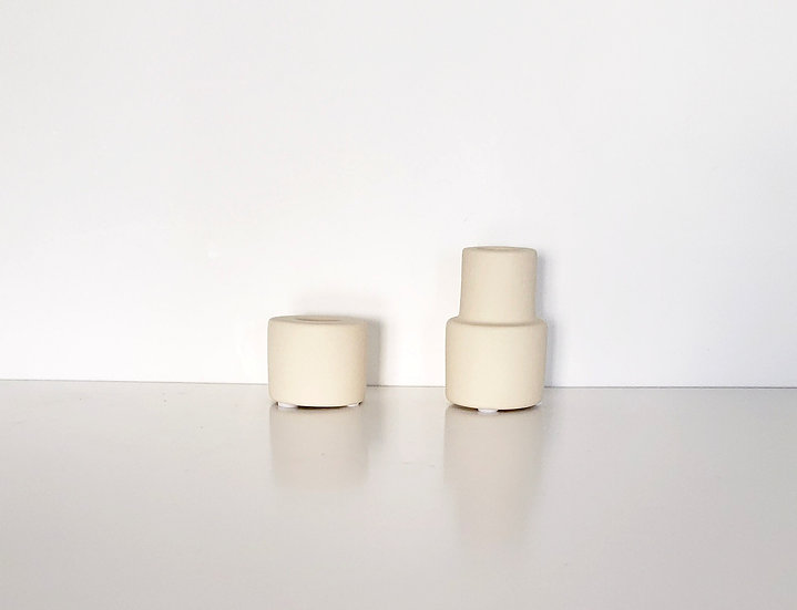 creamy white ceramic taper holder.