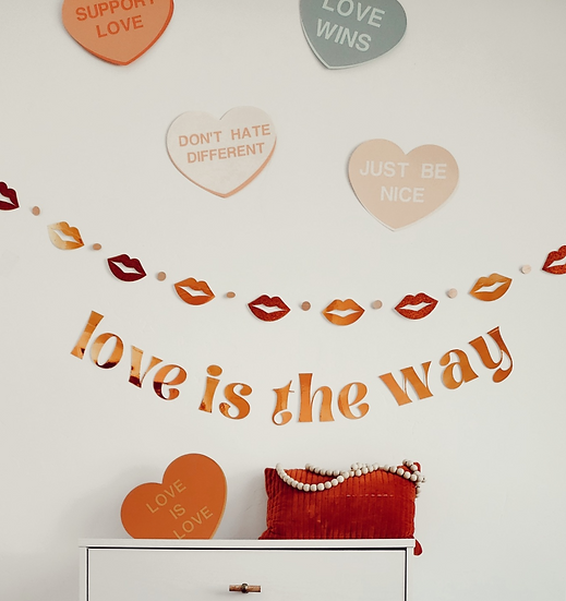 """""""love is the way"""" banner."""