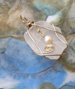 Simple brass and pearl pendant