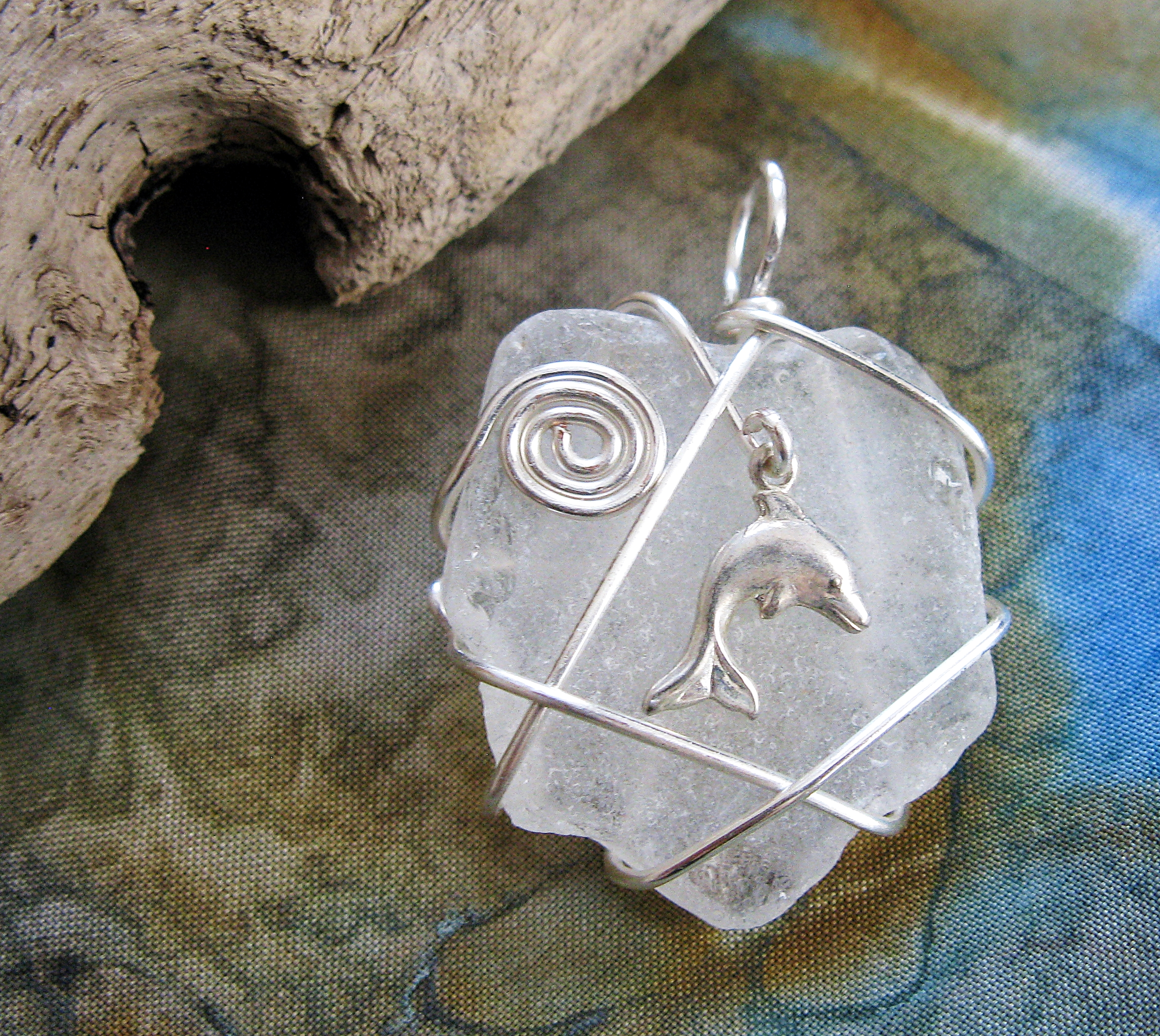 Sea glass pendant with dolphin