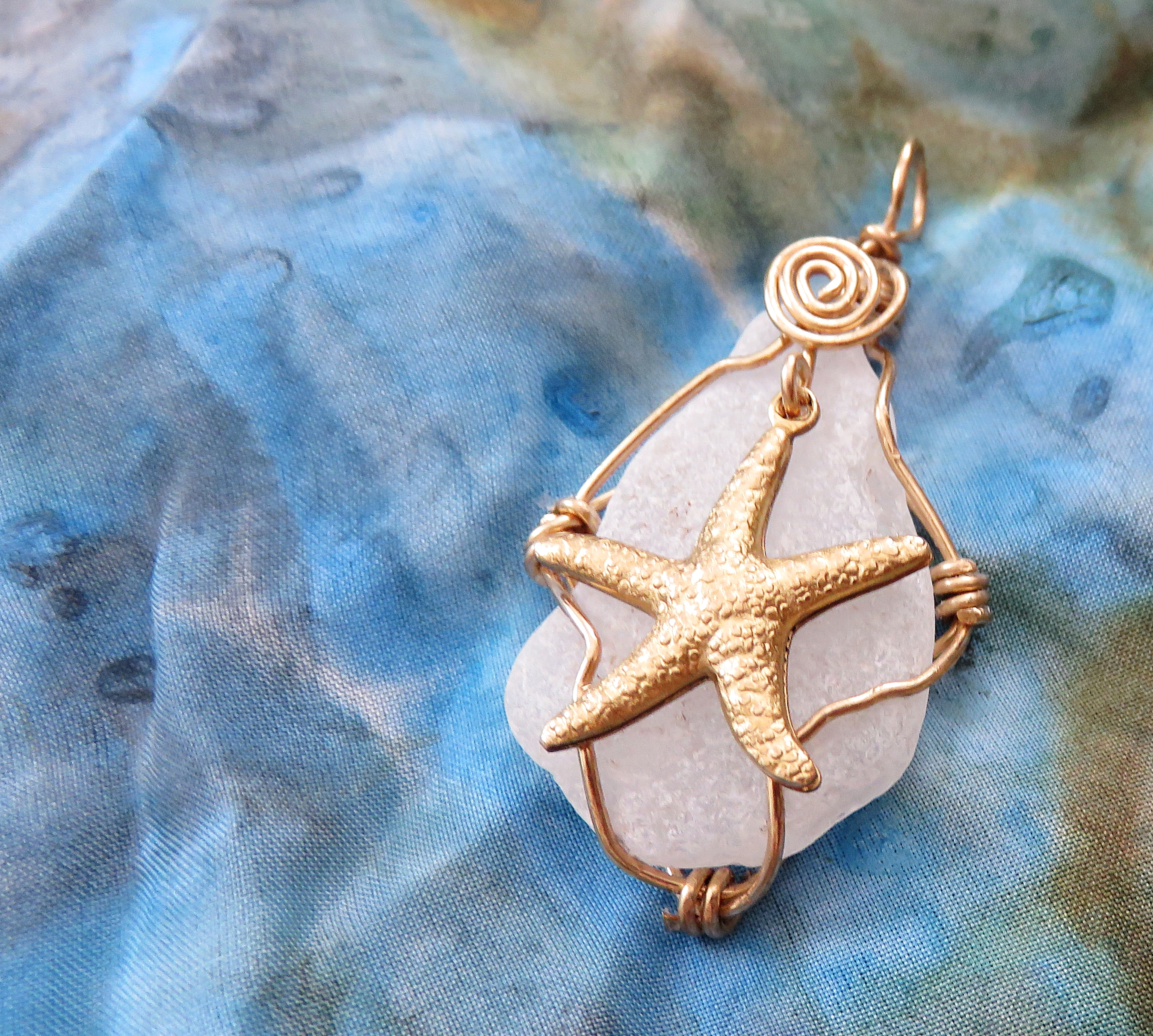 brass cage with large starfish