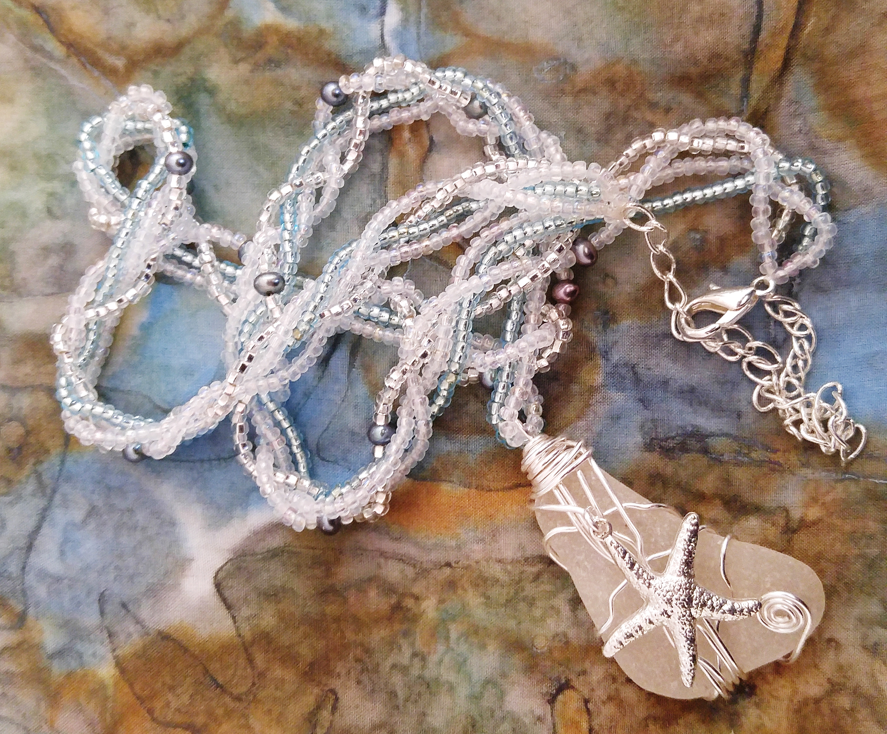 Sea star pendant with braided chain