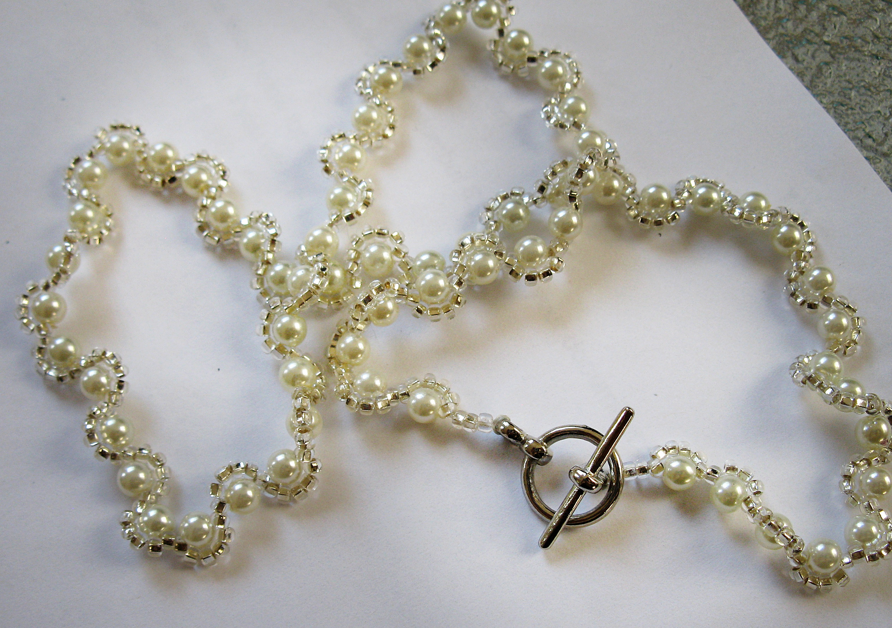 Silver and white with toggle clasp