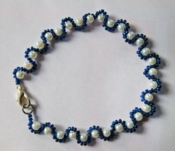 White and navy glass pearl