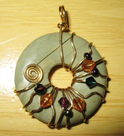 Asymmetrical donut wrap pendant
