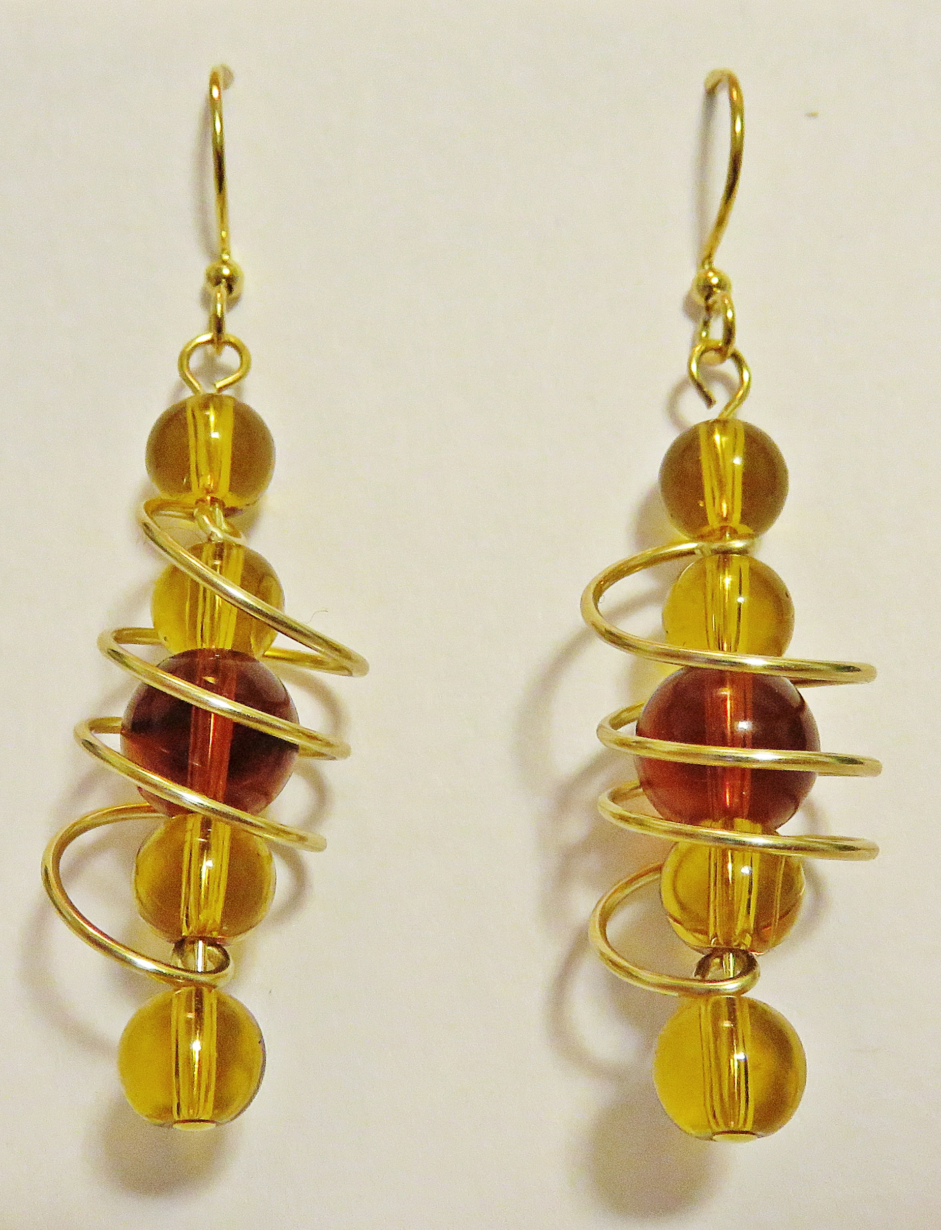 Amber-coloured freeform coil earring