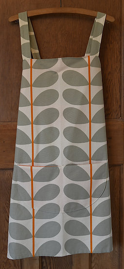 Orla Kiely leaf print apron - grey leaves against a cream background with a pop of orange for the stem