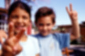 Image of two young kids holding peace sign