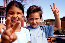 boy and girl make a peace sign