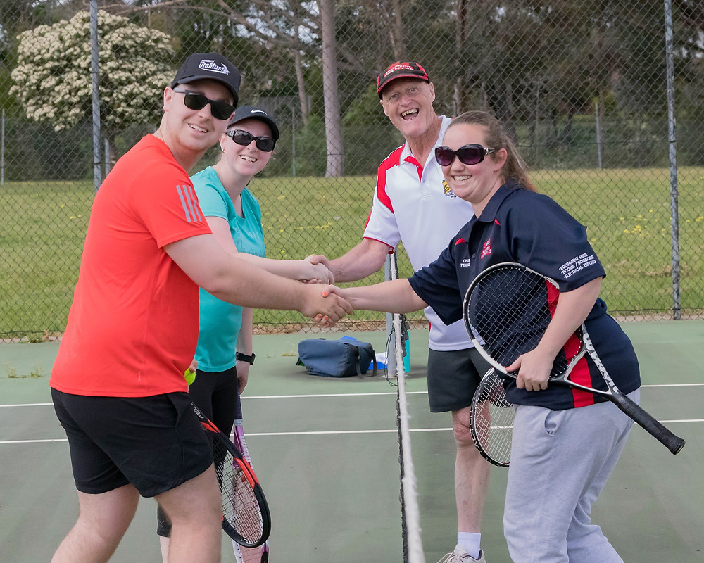 """shaking hands after a great set of """"Fast Tennis"""""""