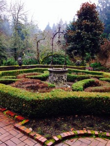 Wishing well and boxwood hedges
