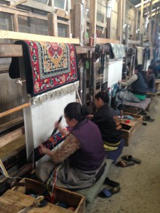 Making rugs at the Tibetan refugee center