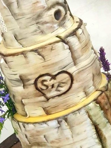 A silver Birch Cake set up at a private