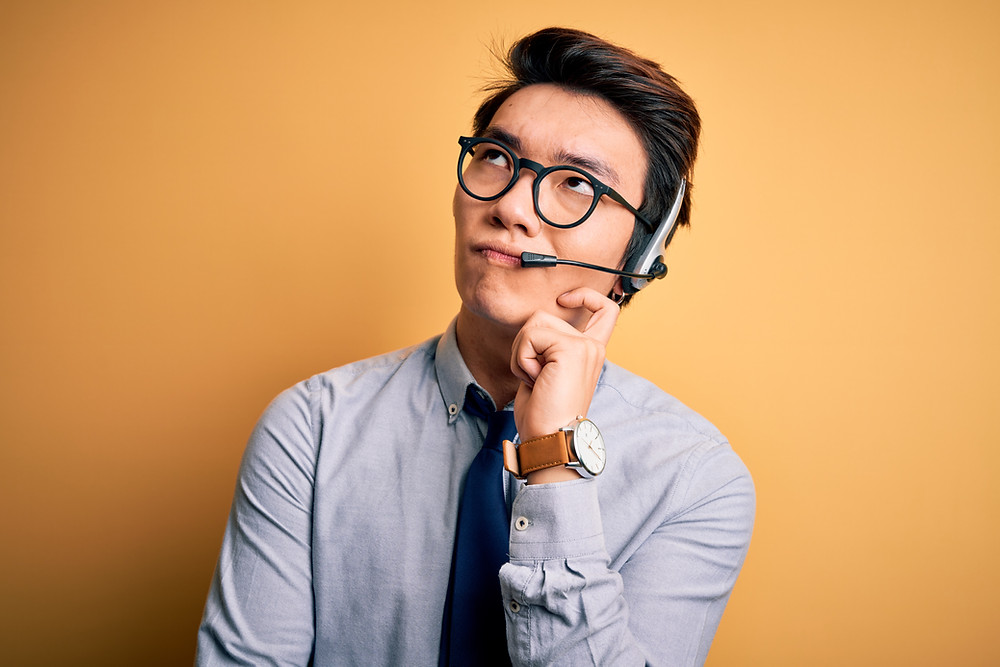 Call center agent thinking about what to say next