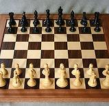 Chess_board_opening_staunton.jpg