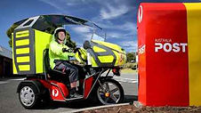 photo-postie-on-three-wheel-bike.jpg.aus