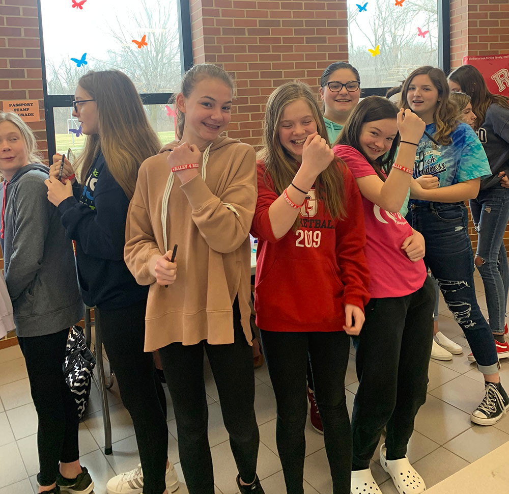 GMS students showing off wrist bands they received after signing Rally for Respect banner