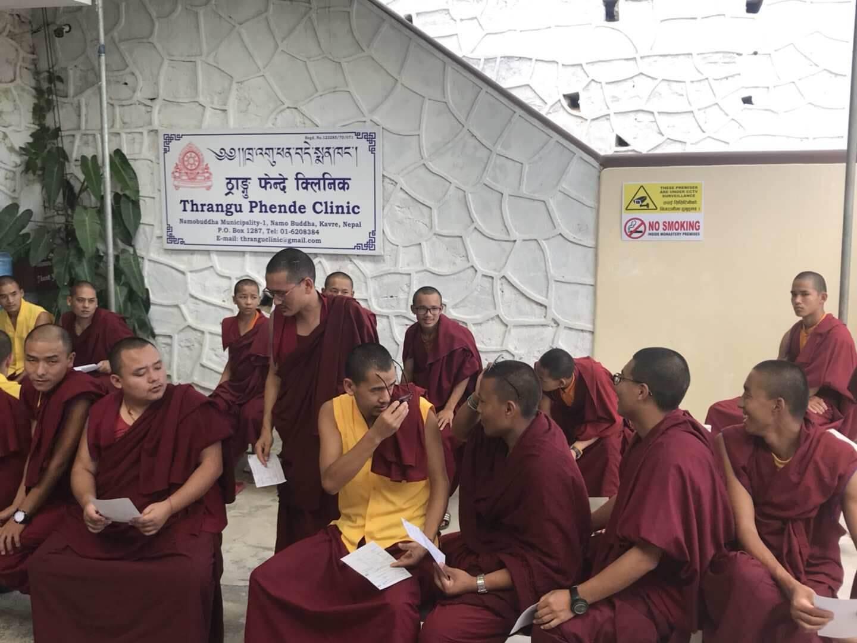 Monks waiting for eye exam