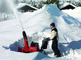 hs1336-hybrid-snowblower-in-use.jpg