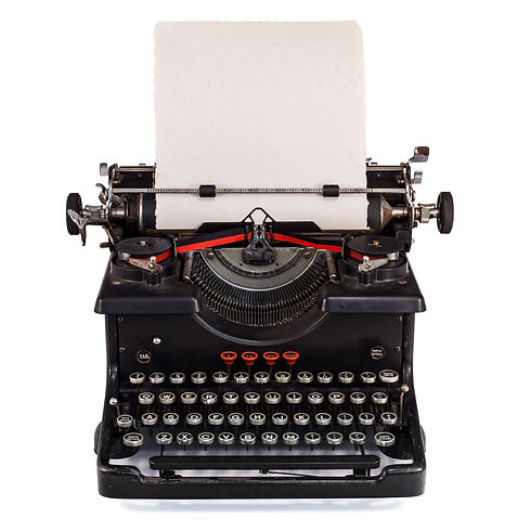 Old Dutch type writer with paper sheet isolated on white