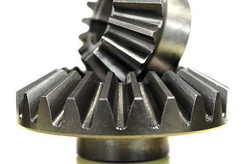 A gear train is a mechanical system formed by mounting gears on a frame so the teeth of the gears en