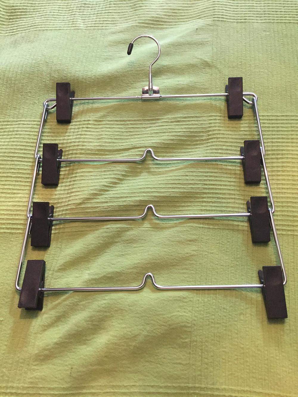 repurposed skirt hanger to organize boots