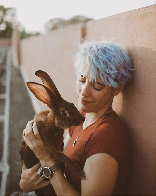 woman-holding-bunny@2x.png
