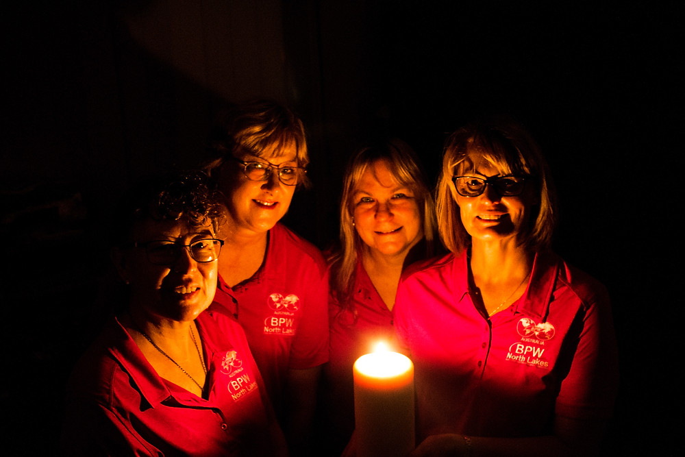 SHINING BRIGHT: BPW North Lakes Committee Member Debbie Ford, President Laurene Coates, BPWA Marketing Director Astrid Kuenne and Candle Lighting Ceremony Coordinator Raylene Teague light candles to encourage women in North Lakes to let their light shine.