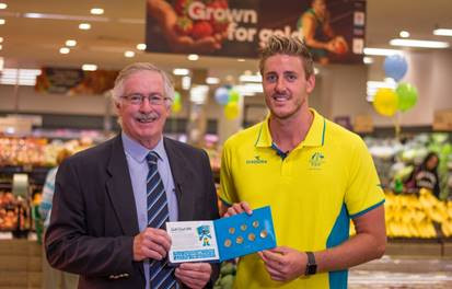 Royal Australian Mint CEO Mr Ross MacDiarmid with Australian Paralympic swimming champion Brenden Hall OAM launching the new limited edition Commonwealth Games coins at Woolworths