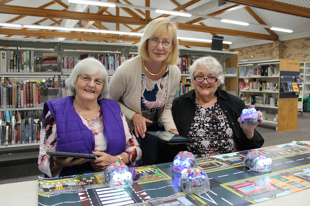 Moreton Bay Region residents Robyn Bottrell, Frieda Piechnick and Catherine Carlile enjoying a 'Robots for Beginners' session