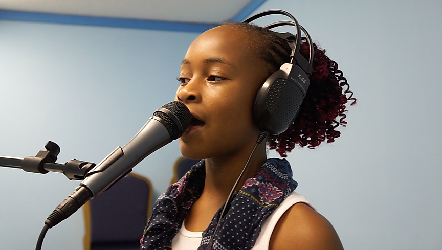 Student recording her first song.