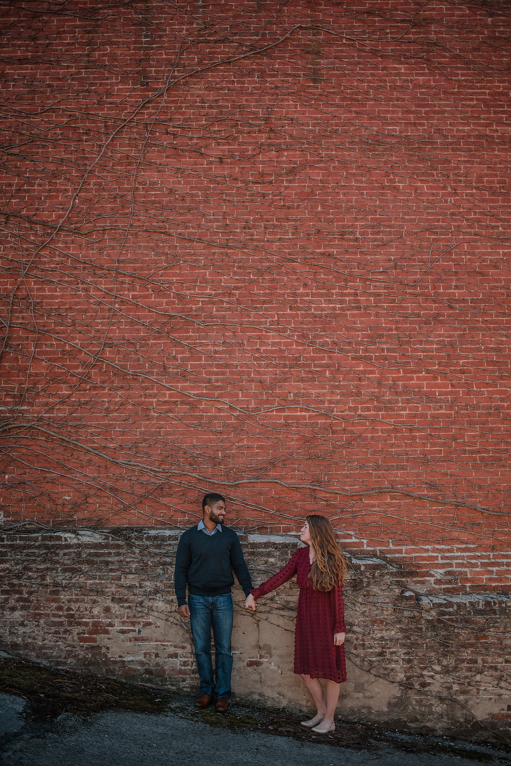 brick wall romantic engagement photo PA