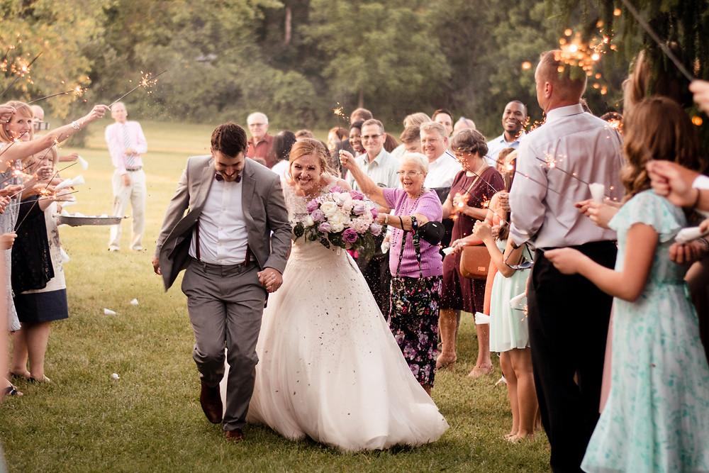 wedding exit, flower petals, lavender buds, wedding photographer, sparkler exit
