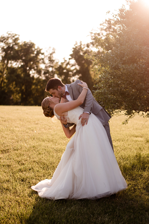 bride and groom, dip kiss, sunset, wedding photographer